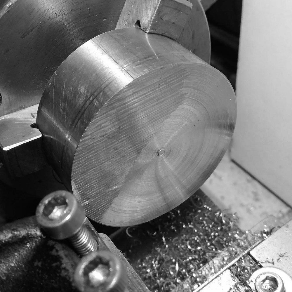 Further turning the face flat, it is a rather slow process as the unevenness creates a hammer effect on the tool bit as it cuts. Thus cuts need to be light.