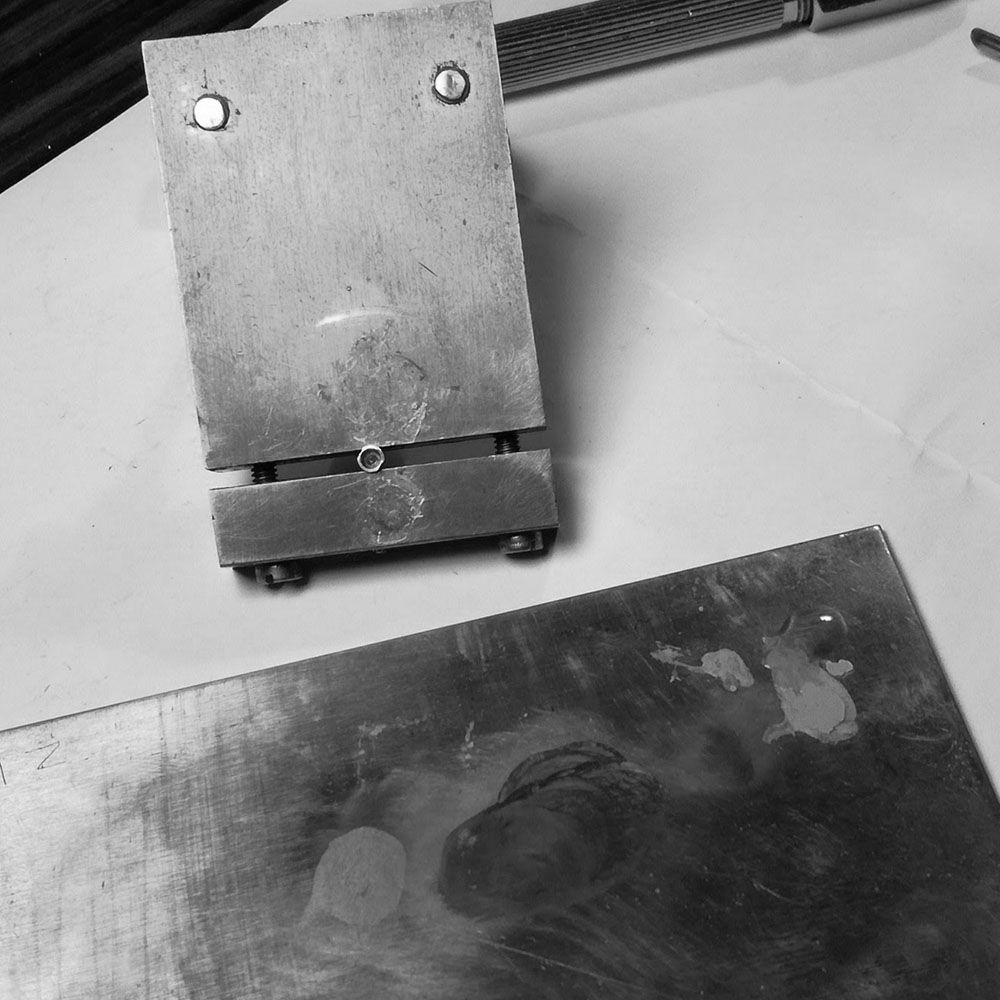 The top of the bushing is polished on a zinc block.