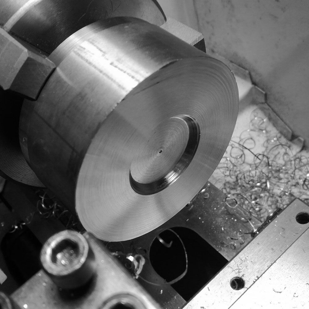 Turning a recess to hold billet from the inside.