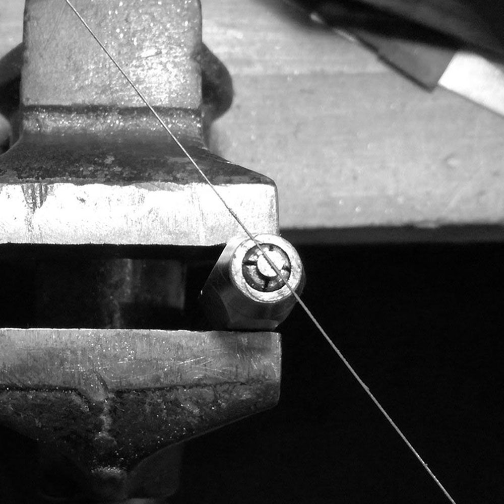 Starting the slot with a jeweler's saw.