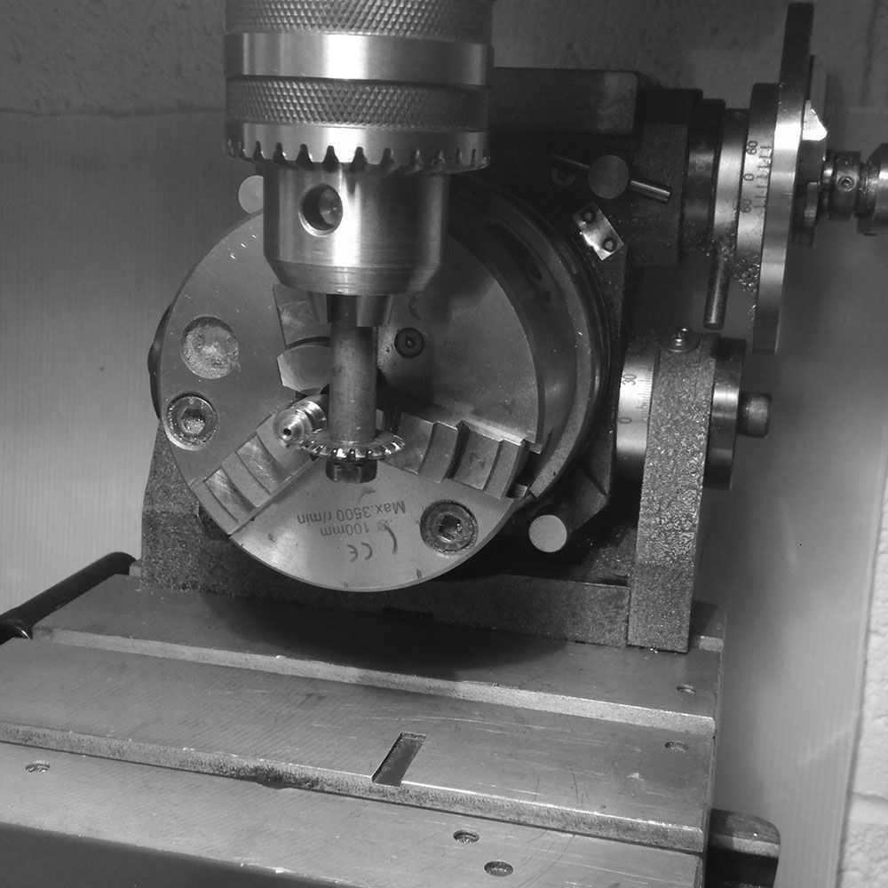 The crown placed into the milling machine.