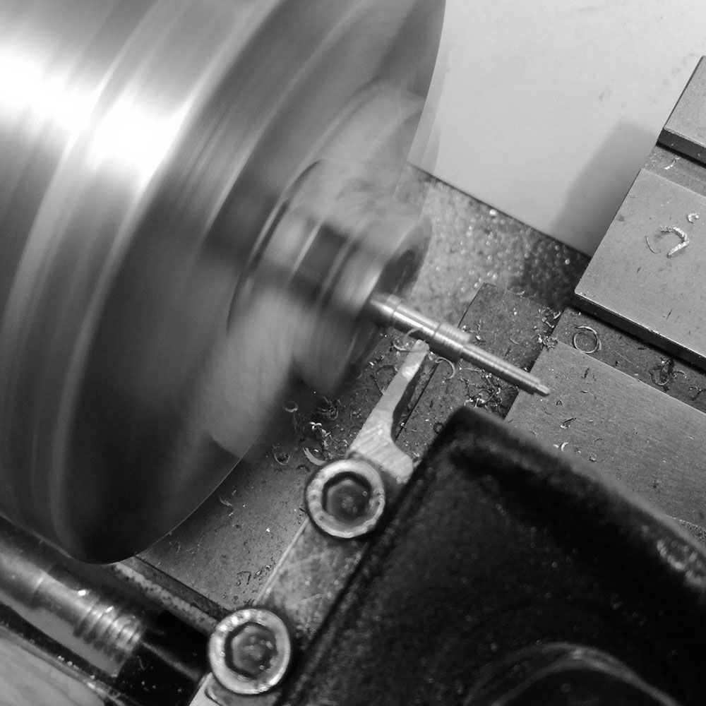 Turning the initial thinner diameter of the minute hand.