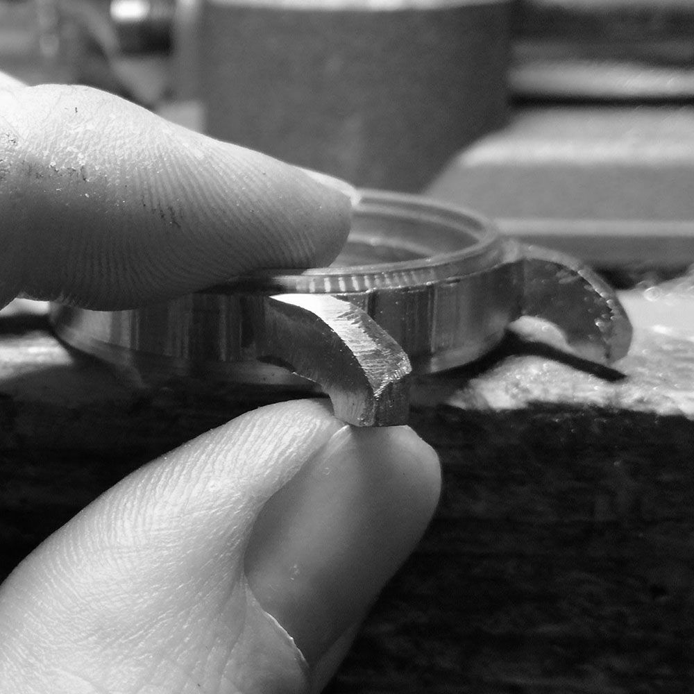 Hand filing to make the lugs become a smooth ribbon that moves evenly downwards.
