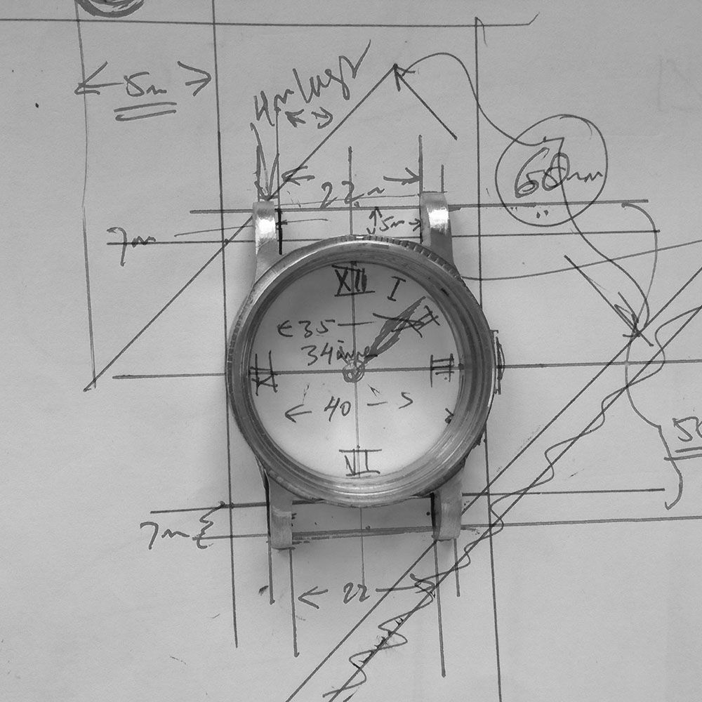 The watch is laid out against the original design.