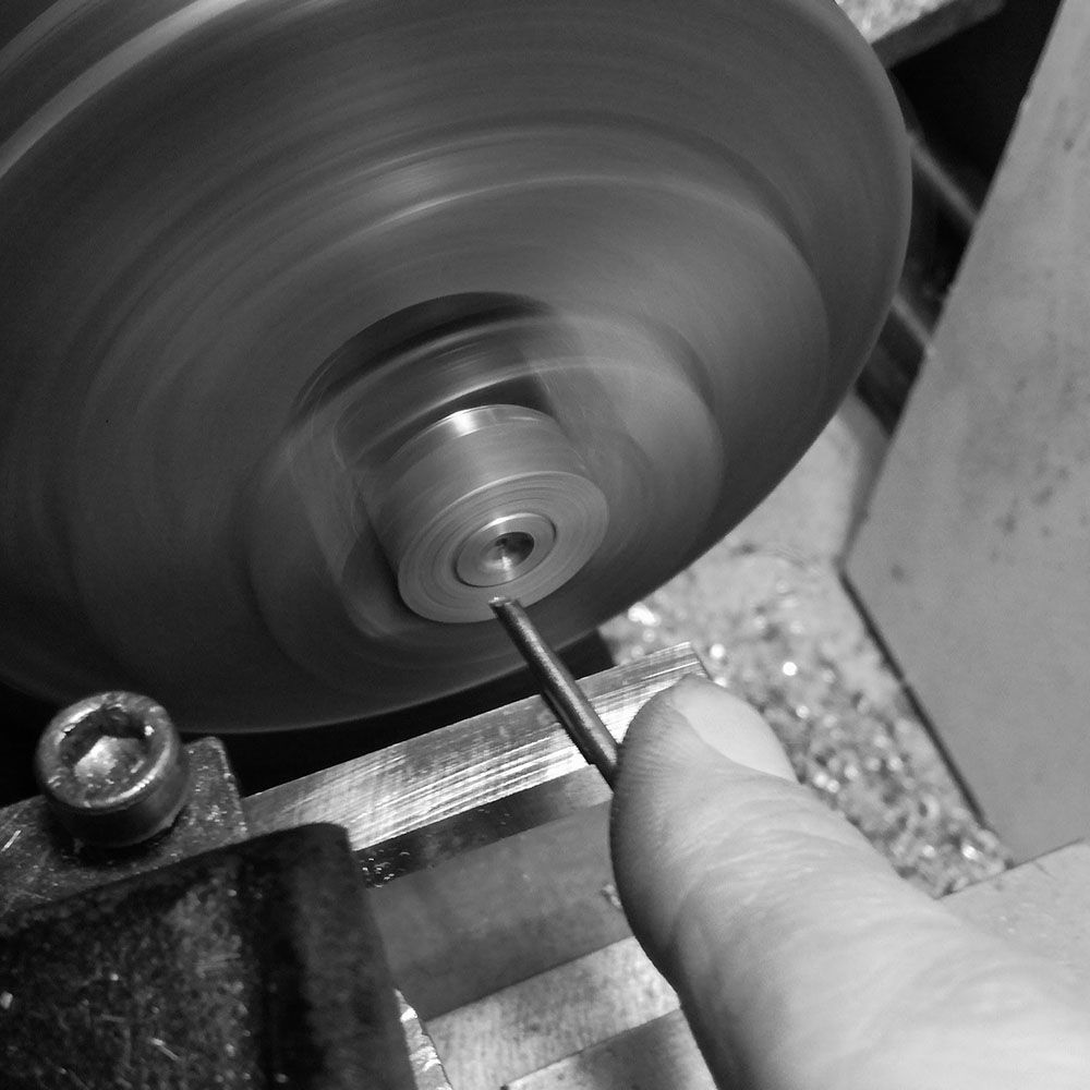 Then I clean the center point with a round hand graver.