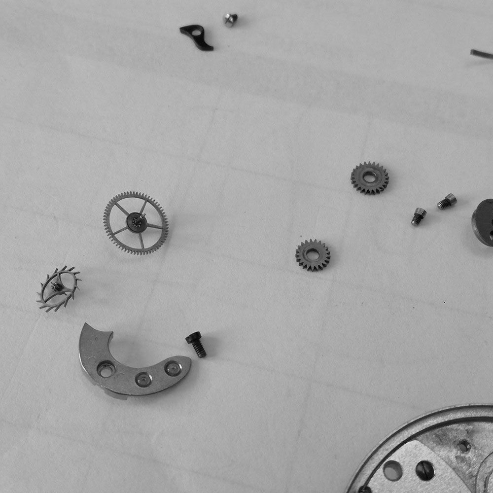 The movement parts are inspected for cleaning, here is the escapement.
