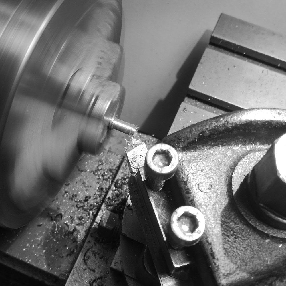Turning a tool steel stem now.