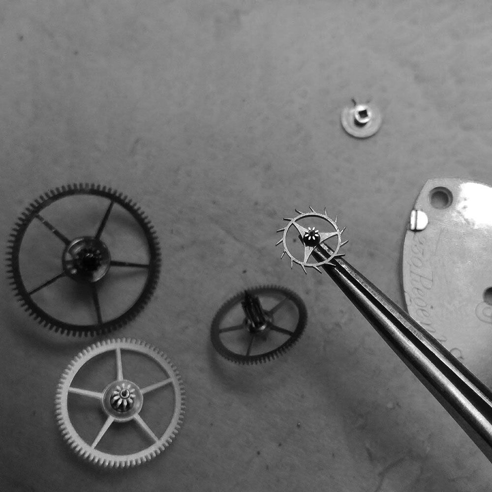 Further cleaning of gears, escape wheel.