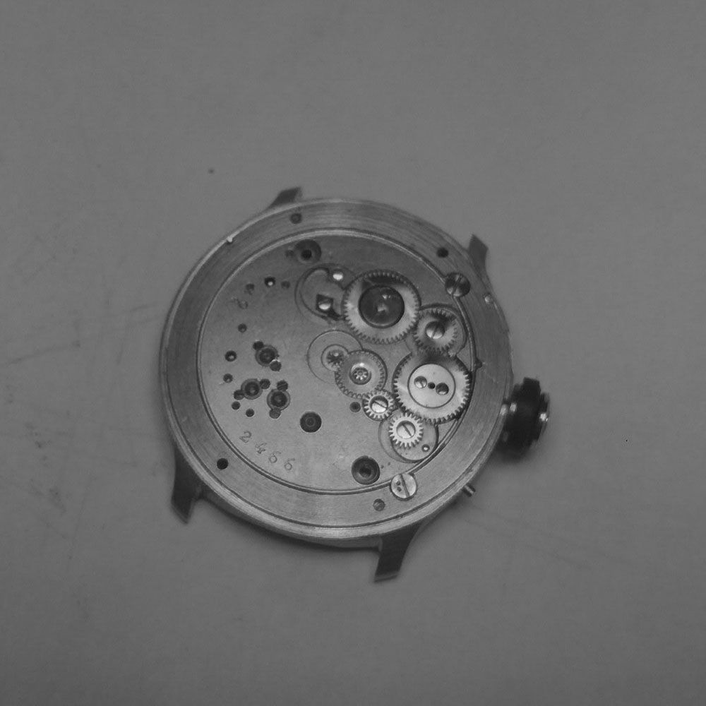 Movement without bezel, held by two screws.
