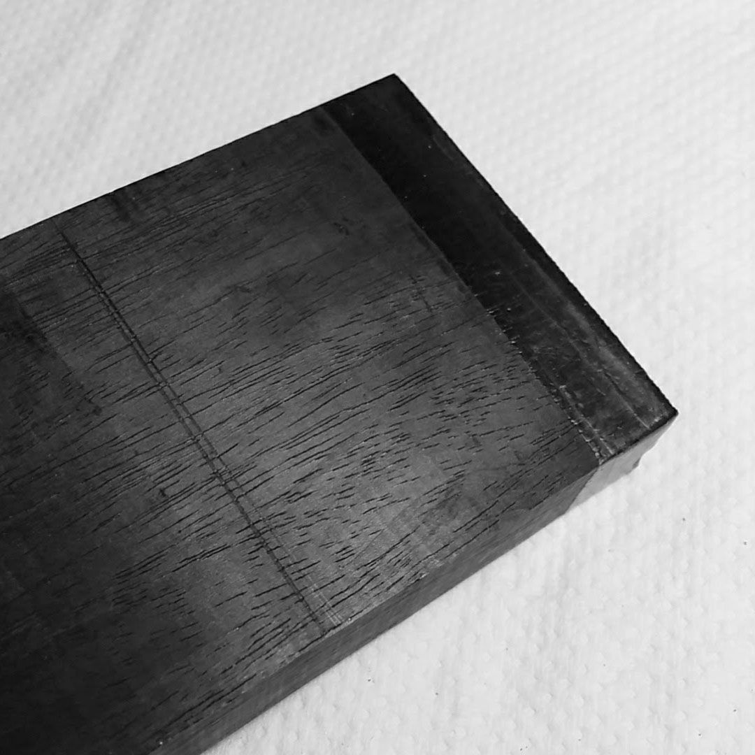 Starting with the solid ebony block for the front and back wood inserts.