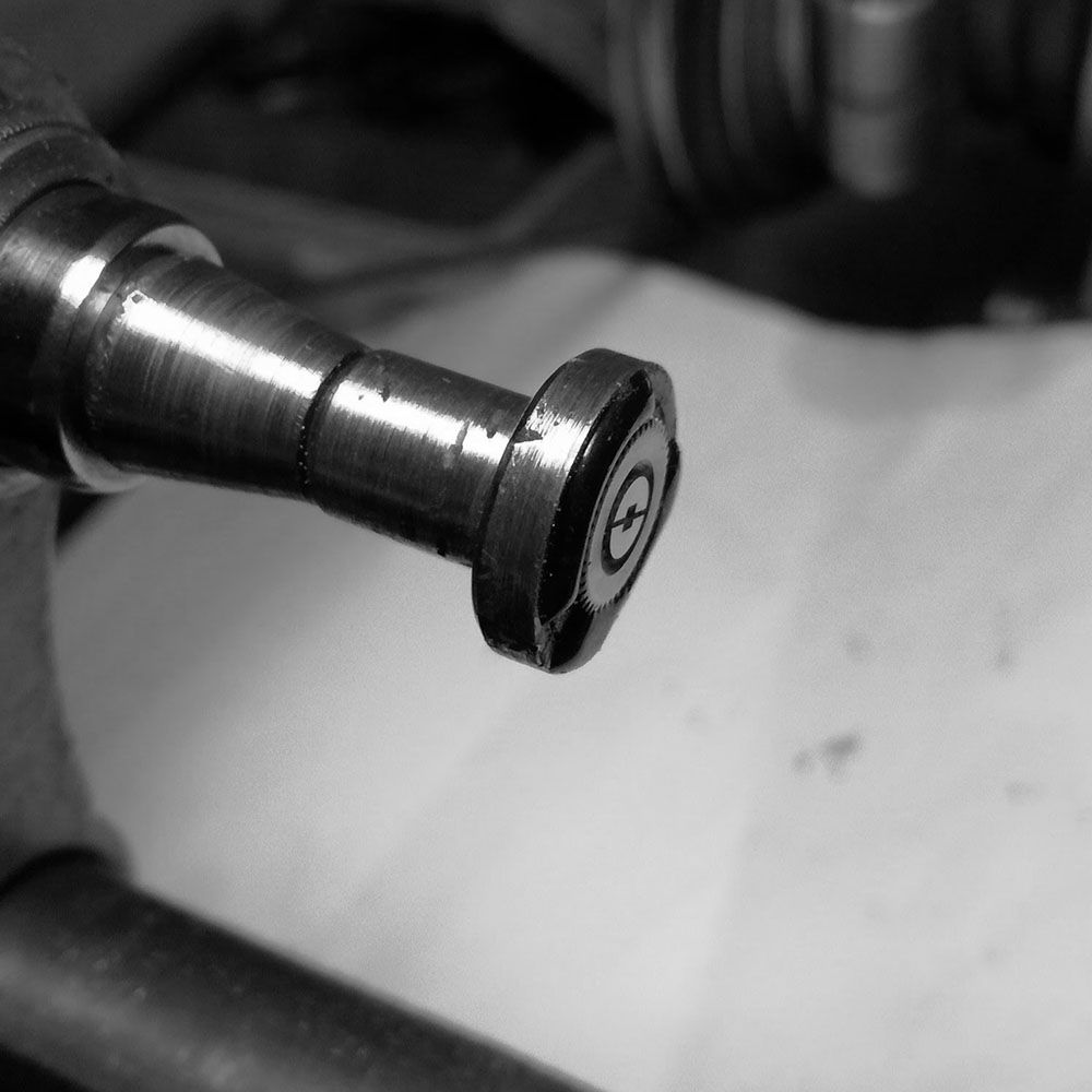 I have mounted the ratchet wheel on the lathe to center it, as it is currently cemented off center.