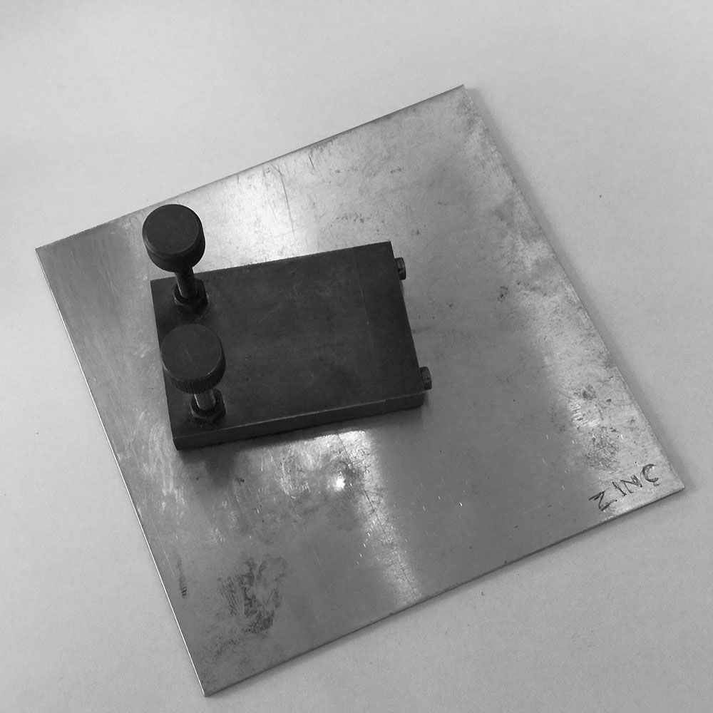 This is a zinc plate and the polishing block.