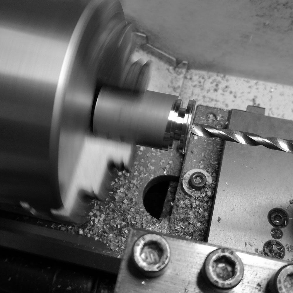 Cutting the central hole to be fitted on the watchmaker's lathe.