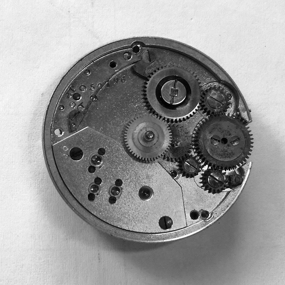 Dial side of movement, showing surface rust on the keyless gear.