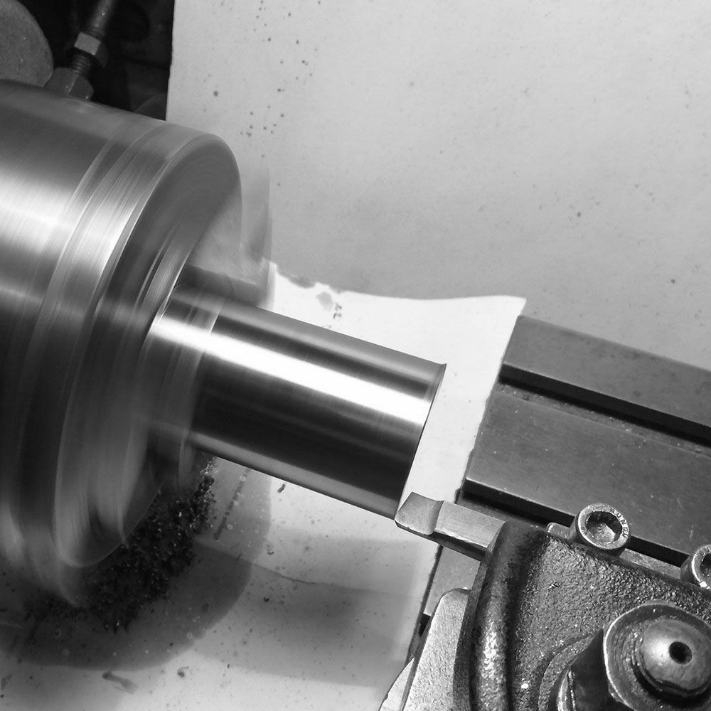 Next turning a larger steel disc.