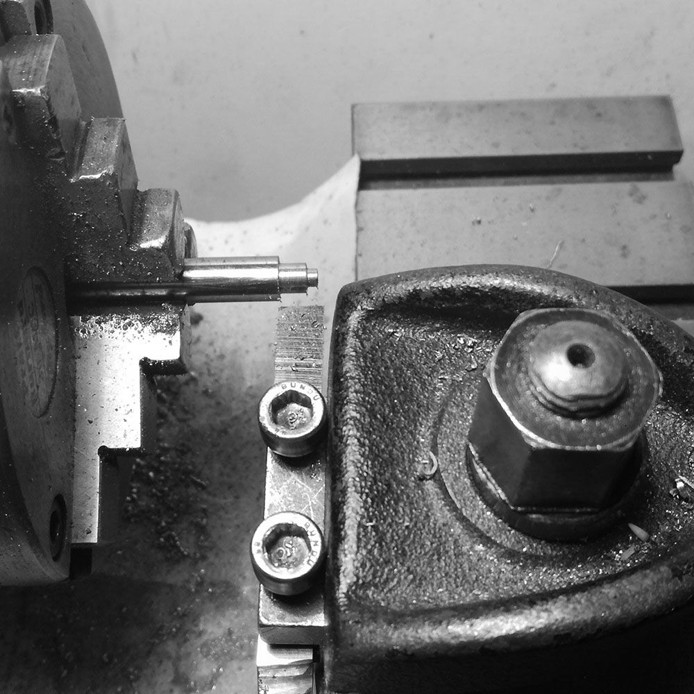 A pin is being manufactured to create the pivot where the spindle will rotate and create the correct angle.
