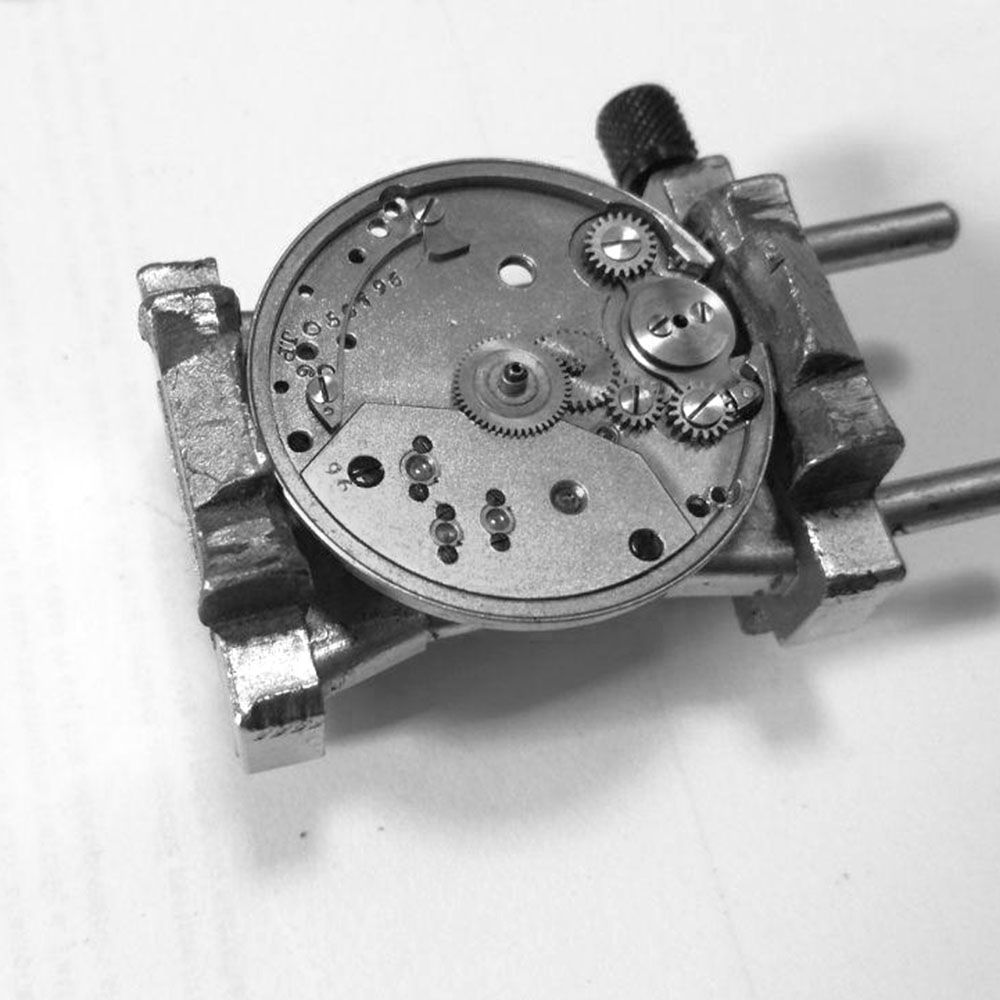 The movement dial side being temporarily assembled. The two large ratchet wheels are missing.