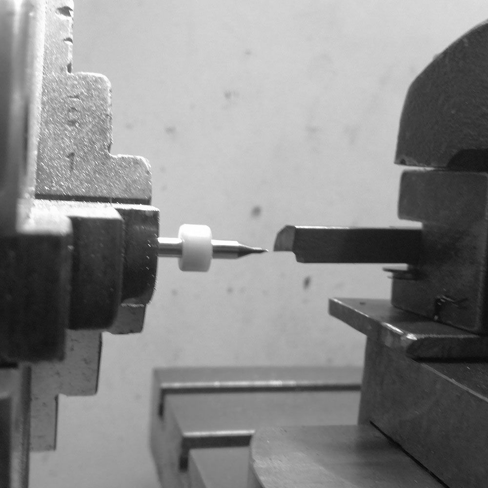 Checking the centering of the threading tool on lathe. The threading tool is reversed for this operation.