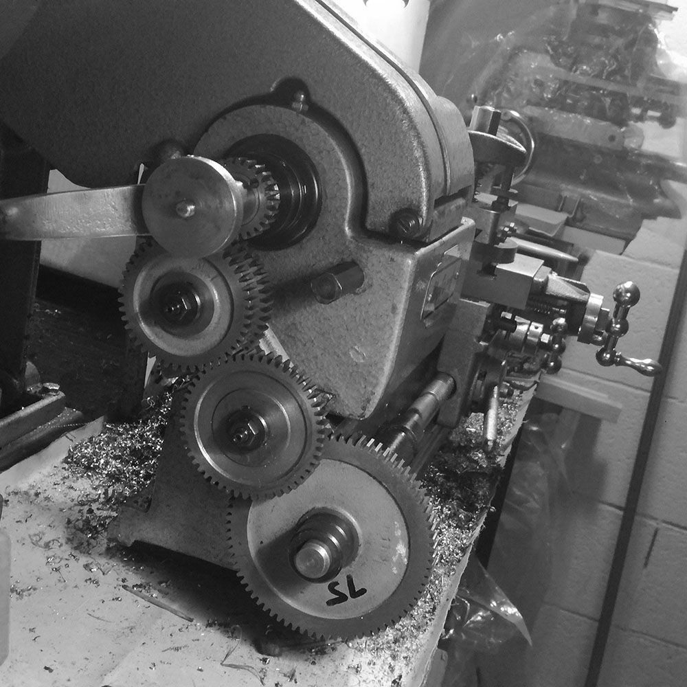 The lathe is fitted with change-gears to change the imperial thread to metric.