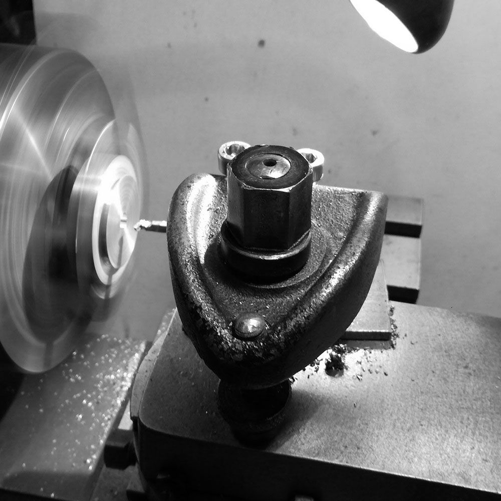 Machining the test piece of bronze to try out the engraving.