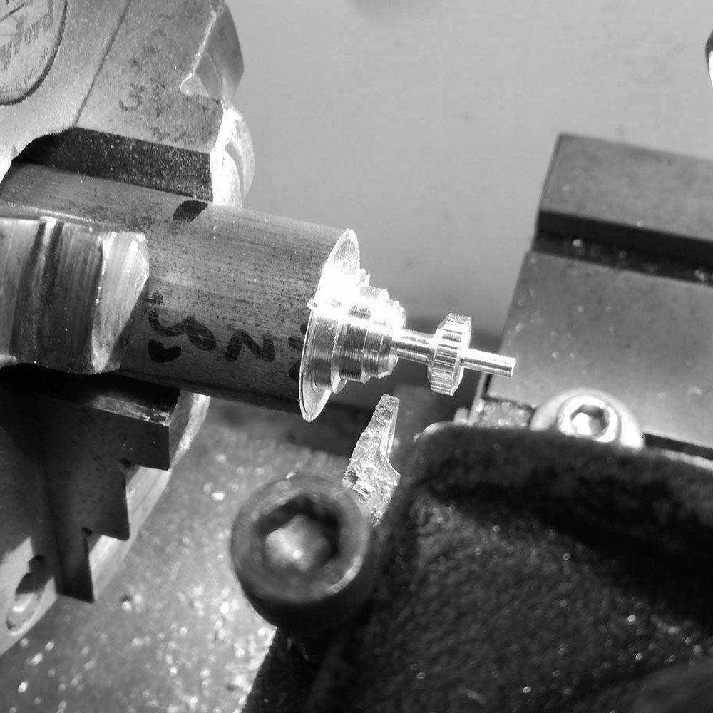 I leave a stem on the outside of the crown so that I can grab it in the smaller watchmaker's lathe to finish the crown.
