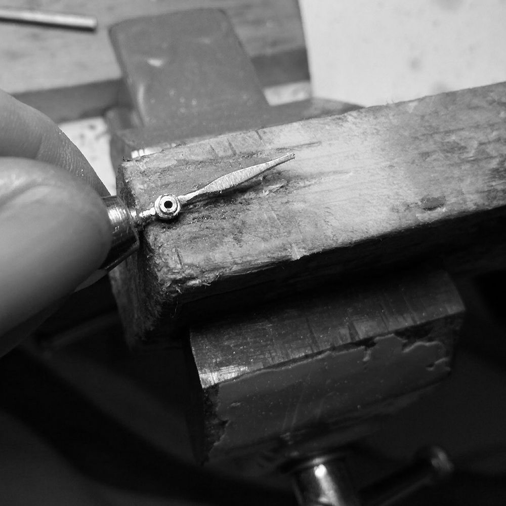 Shaping and flattening with hand file.