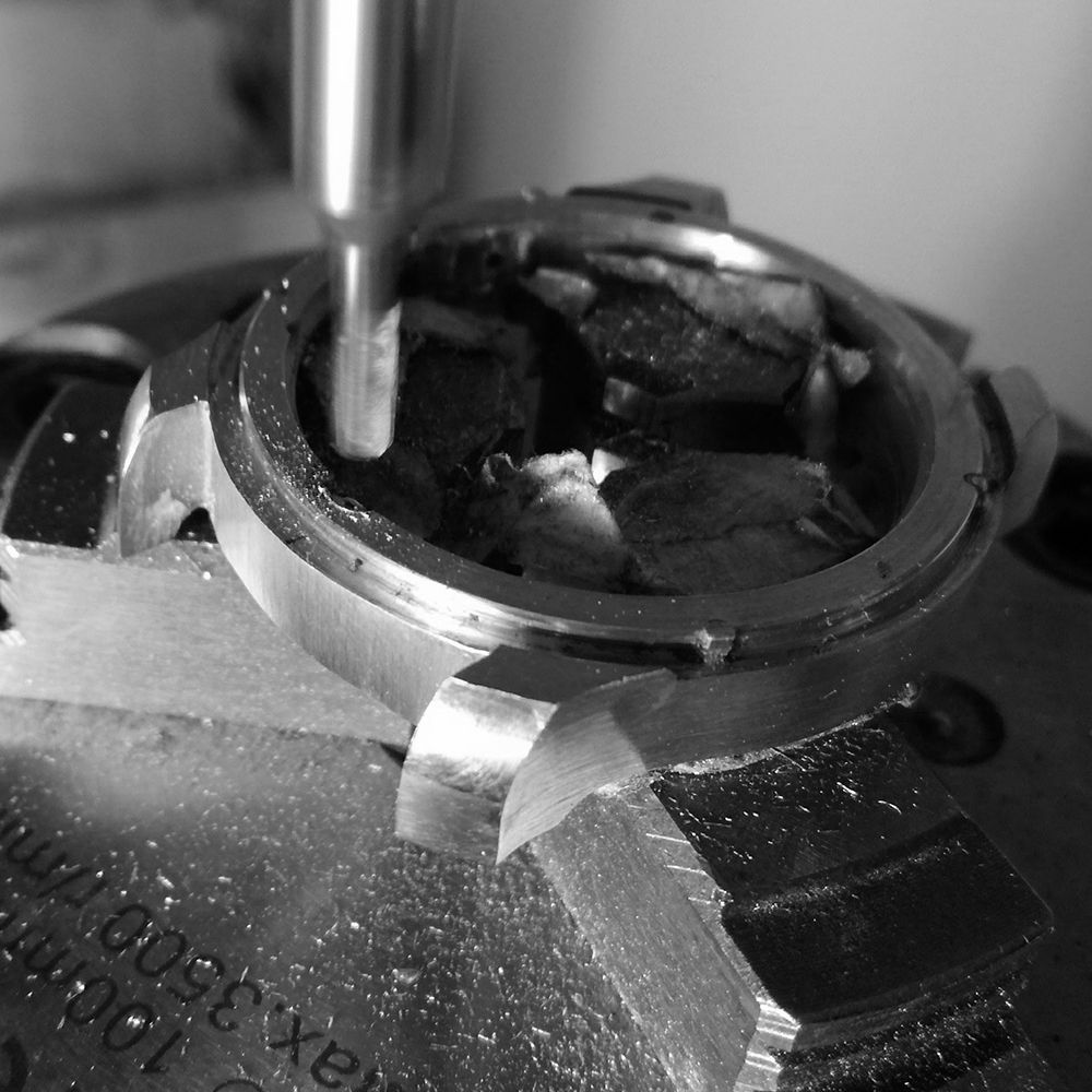 Milling out movement retaining screw area on case.