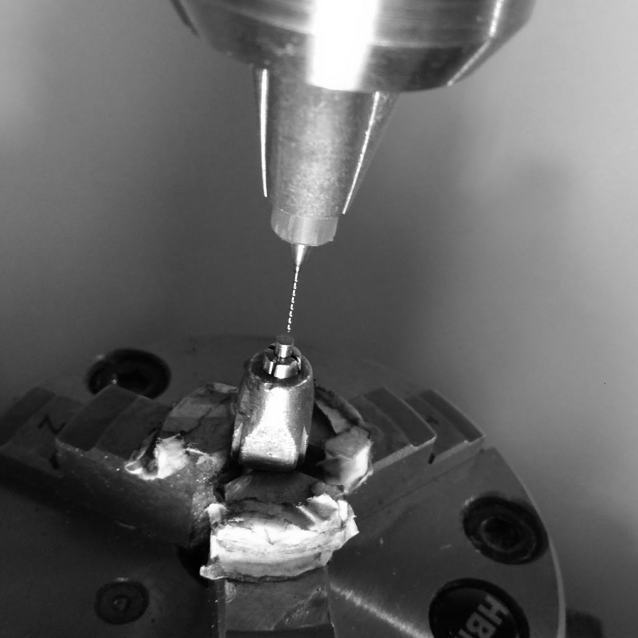 Further drilling of hole for retainer screws in stem.