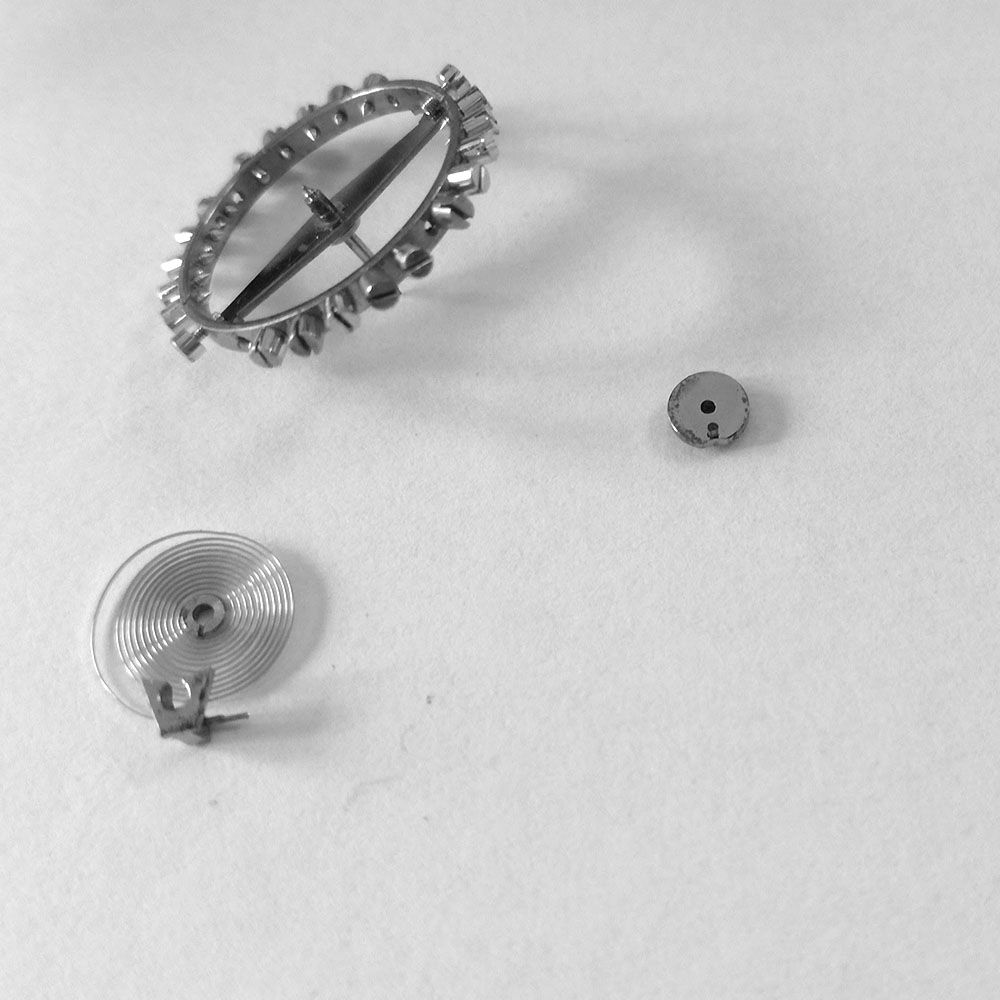Balance hairspring and impulse jewel and roller disassembled.