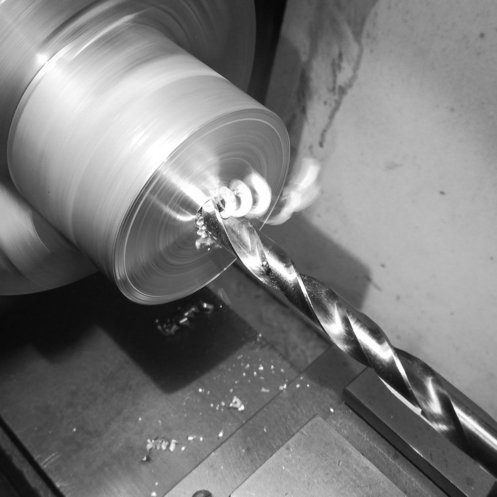 A solid aluminum billet is faced off, and center drilled.