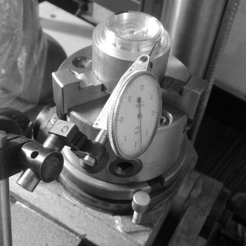 Since the billet is not perfectly concentric, a dial indicator is used to keep the indexes aligned during milling.