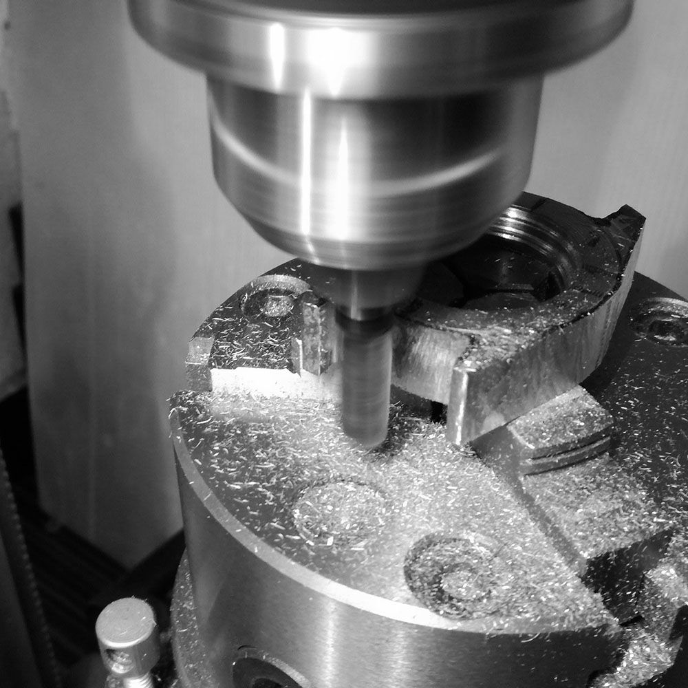 Further milling of case end square lugs.